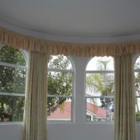 Curved curtain track with valance
